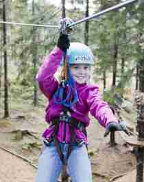 A girl in a zip line in Oslo Sommerpark, Eastern Norway