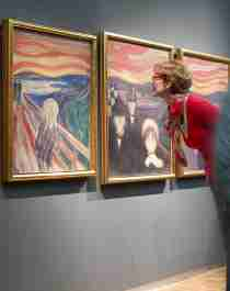 People looking at Edvard Munch's Scream at The Munch Museum in Oslo