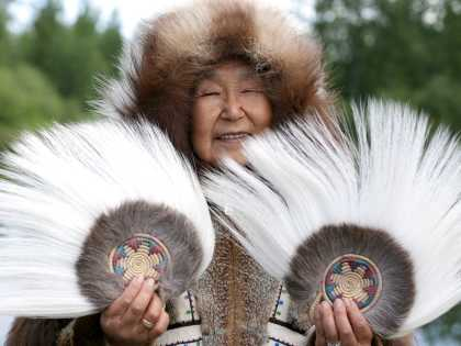 Alaska Native people; woman with fans