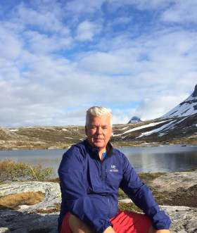 Bjørn Heitmann sitting by mountain lake, Bodø Northern Norway