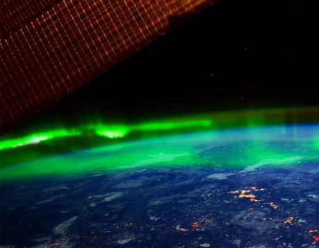 The northern lights hovering above the earth