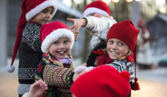 Children with Christmas hats at the Norsk Folkemuseum, Oslo, Eastern Norway
