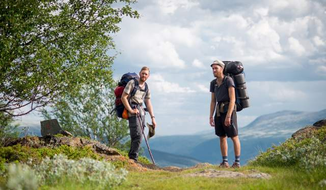 Two man with backpacks during a pilgrimage in Dovrefjell, Eastern Norway