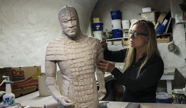 A sculptor in a workshop in Bryggen in Bergen, Fjord Norway