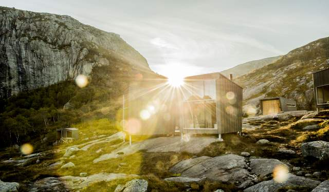 Skåpet cabin with the setting sun behind it, in Ryfylke, Fjord Norway