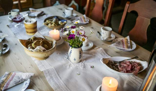 A table with food at Sørre Hemsing in Valdres, Eastern Norway