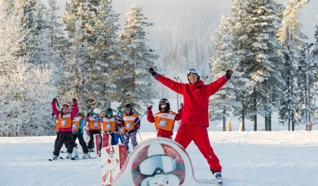 Children skiing with an instructor in Trysil ski school, Eastern Norway