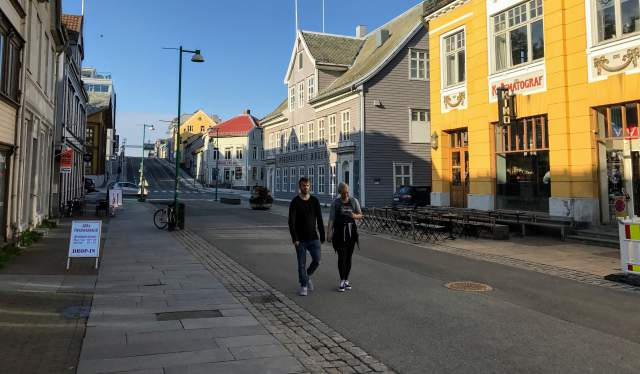 Two people walking down a street in Tromsø city centre in Northern Norway