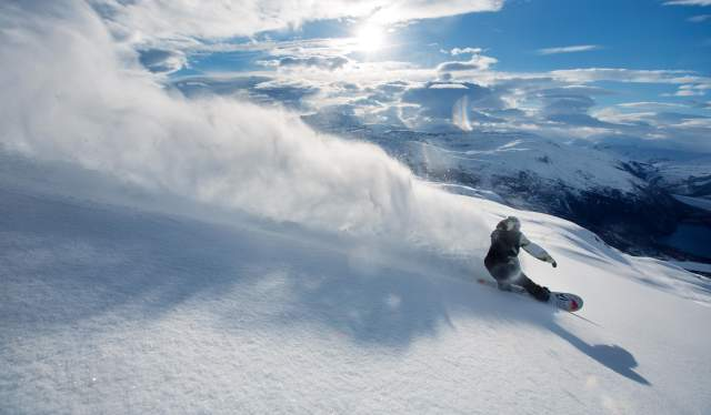 A person snowboarding in Meløy in Helgeland, Northern Norway