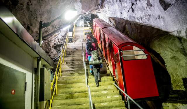 People entering the Gaustabanen cable car inside of Mount Gaustatoppen in Telemark, Norway