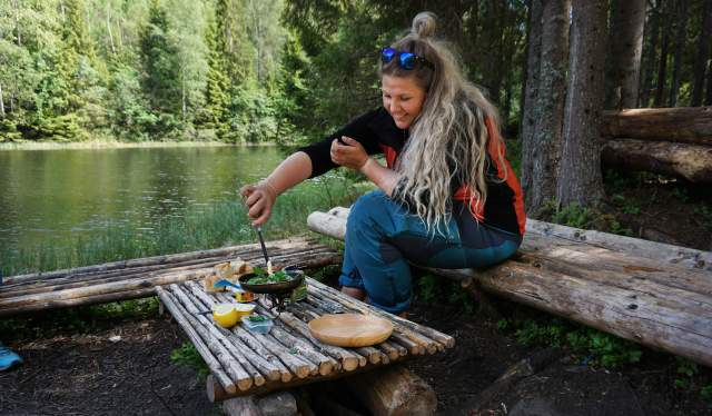 A woman cooking up the catch after freshwater fishing in a lake in Akershus, Eastern Norway