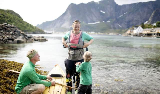 A family with a kayak in Lofoten, Northern Norway