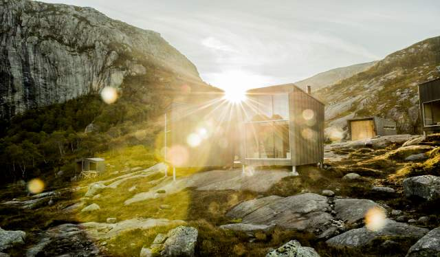 View of design cabin Skåpet with the setting sun behind it, in Ryfylke, Fjord Norway