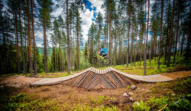 A person cycling on an obstacle in Trysil bike arena in Eastern Norway