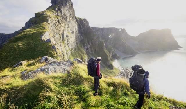 Two people hiking in Værøy in the Lofoten Islands in Northern Norway