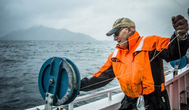 Svein Kristiansen on the «Elltor» fishing boat outside Nusfjord in Lofoten