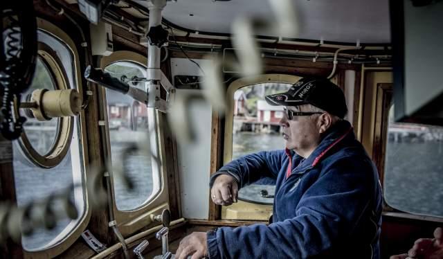 Jan Martin Johansen driving his fishing boat «Elltor» in Nusfjord in Lofoten, Northern Norway