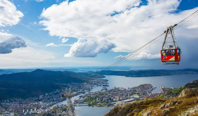 The Ulriken cable car in the foreground with Bergen city, Fjord Norway, in the background with the surrounding fjord and mountains.