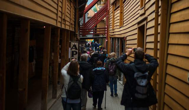 People photographing at Bryggen in Bergen, Fjord Norway