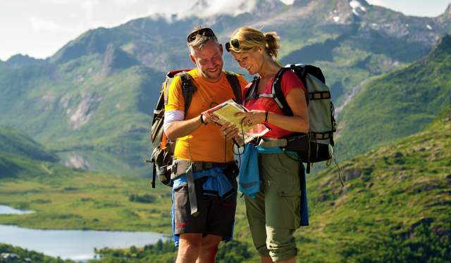 Couple mapreading in the mountains of Lofoten, Northern Norway