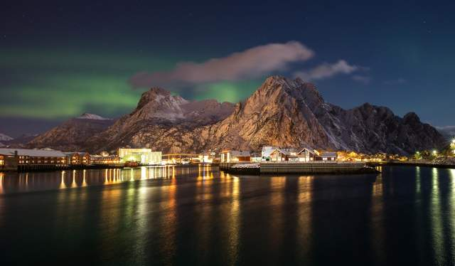 Northern lights over Svinøya Rorbuer in Lofoten in Northern Norway