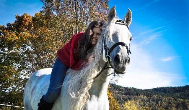 Wwoofer Mette Pauline Strand on a horse in Norway