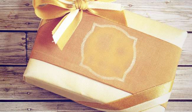 gift wrapped in gold paper and tied with a bow