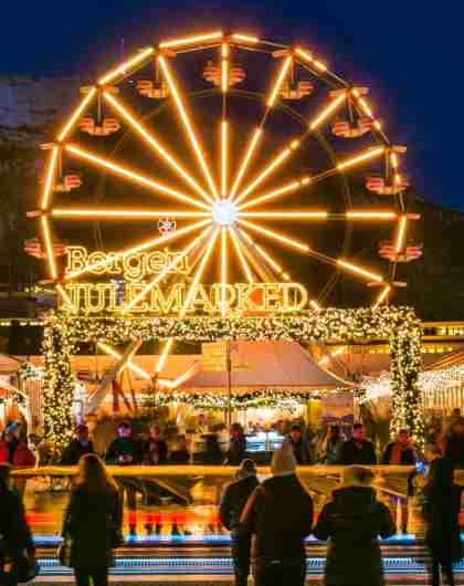 Christmas market in Bergen with Ferris wheel and Christmas lights