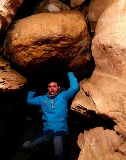 A man inside the Grønligrotta cave in Helgeland in Northern Norway, one of many exciting caves and caverns