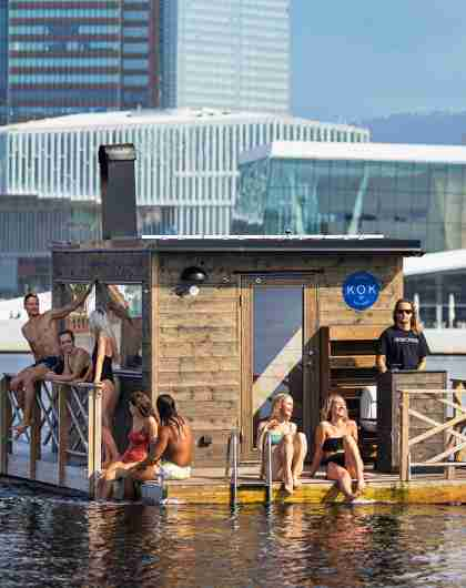 People on the floating sauna KOK Oslo in the Oslofjord, Eastern Norway