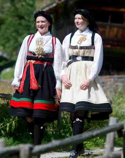 "Two girls dressed in Norwegian national costume ""bunad"" from sustainable destination Setesdal."