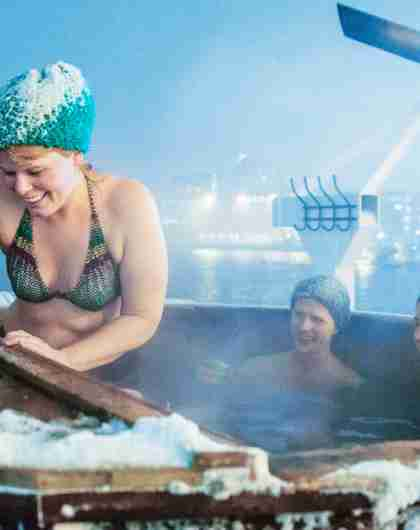 People bathing in the jacuzzi at the Vulkana spa boat in Tromsø harbour, Northern Norway