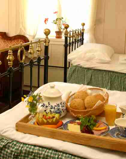 Get breakfast in bed at Baroniet Rosendal on a manorial country holiday in Norway
