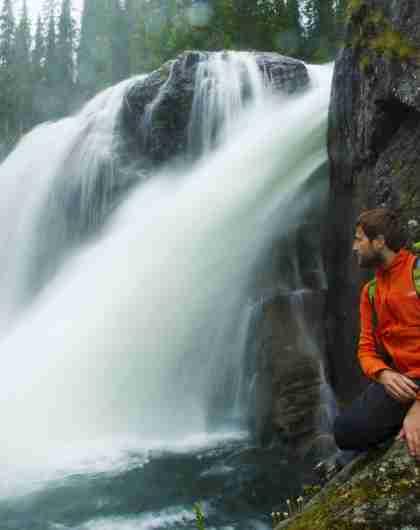 A man next to Rjukandefossen waterfall in Hemsedal, Eastern Norway