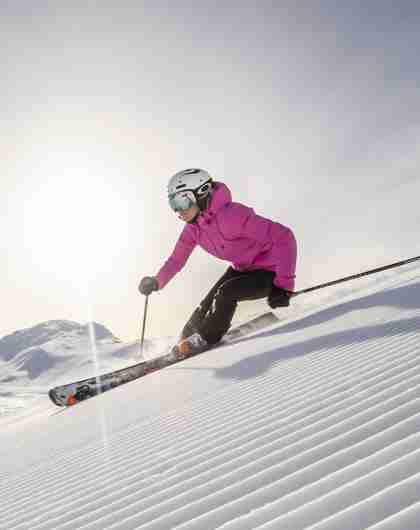 A woman skiing down an alpine slope in Hemsedal in Eastern Norway