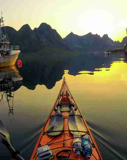Kayaking into the midnight sun on Kjerkfjorden in Lofoten