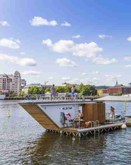 The floating Oslofjord sauna in front of Oslo opera house, Eastern Norway