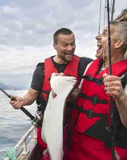 Two men in a boat sea fishing in Tromsø in Northern Norway