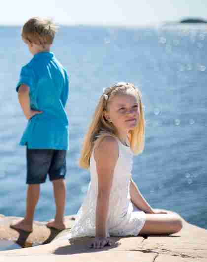 Two children by the sea at Bragdøya in Kristiansand