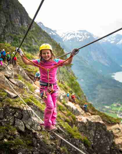 Young girl crossing the Via Ferrata in Loen in Fjord Norway