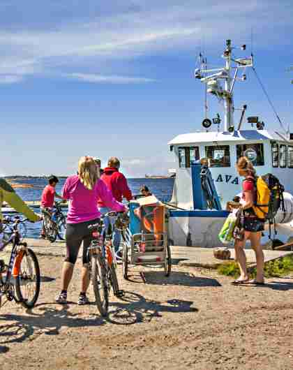 People are boarding the boat to go island hopping in Hvaler by the Oslofjord in Eastern Norway