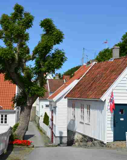Charming wooden houses in Skudeneshavn outside of Haugesund in Fjord Norway, a coastal gem in southern Norway