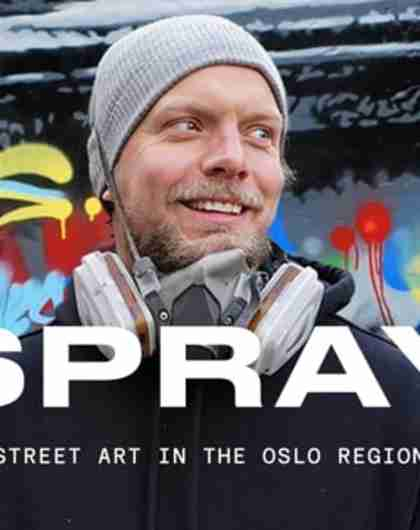 Martin Whatson standing in front of one of his murals in the Oslo region