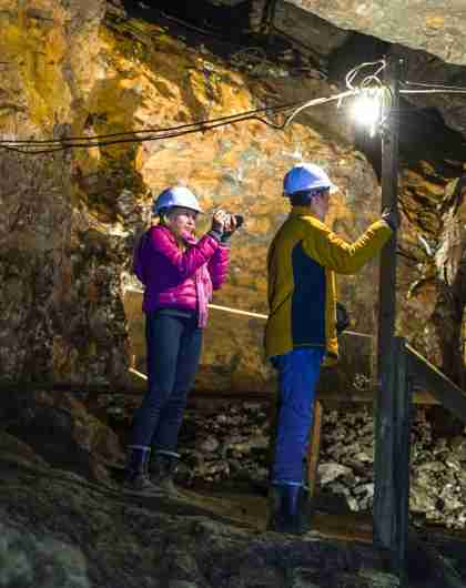 Three people are exploring Olav's mine in Røros in Trøndelag, Norway