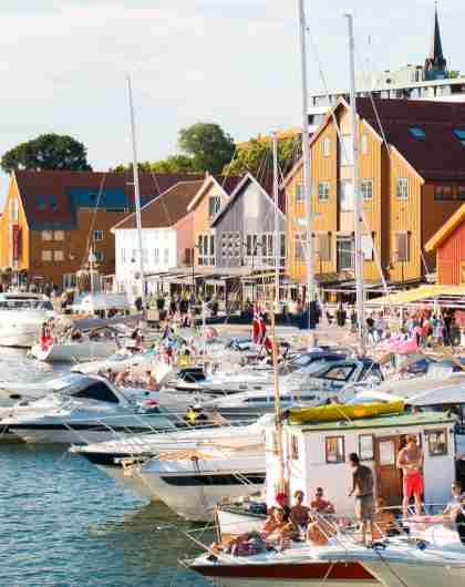 Boats and people in Tønsberg harbour in Vestfold, Eastern Norway, a sunny summer day