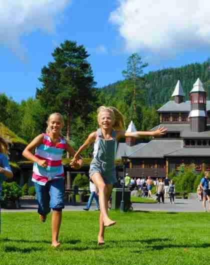 Children playing outside on a sunny summer day at Hunderfossen family park