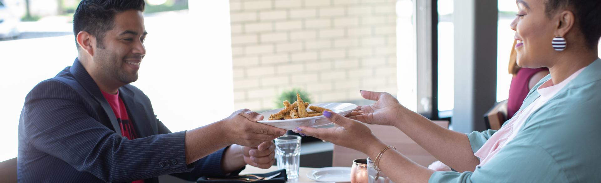 Two People Dining Together at Forty Acres Soul Kitchen.