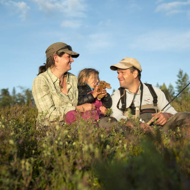 A family of three is fishing in the Blefjell mountain area in Eastern Norway