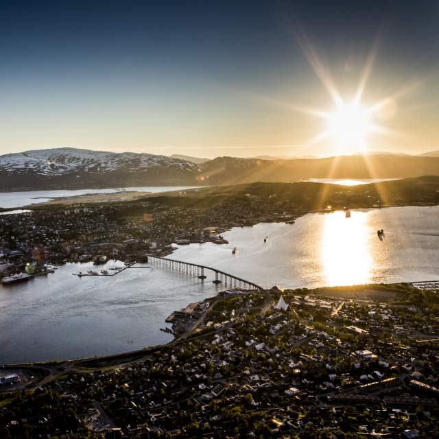 View on Tromsø and the midnight sun from the Storsteinen viewpoint, Northern Norway