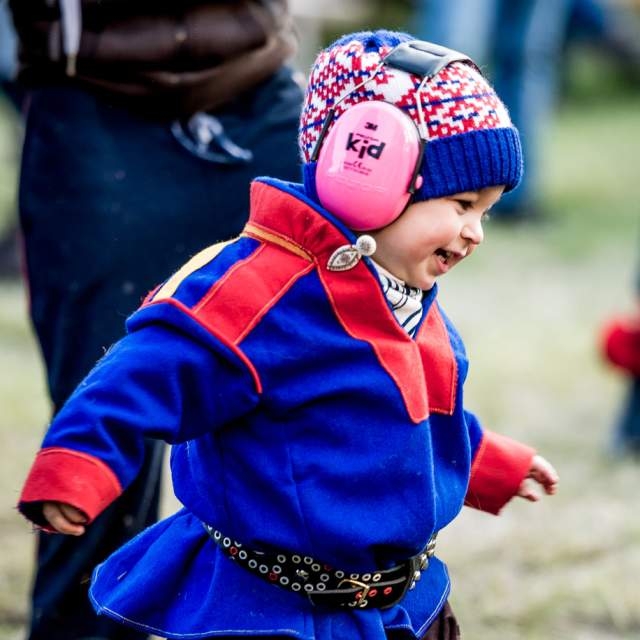 Child with ear protection at the Riddu Riđđu festival, Manndalen, Northern Norway